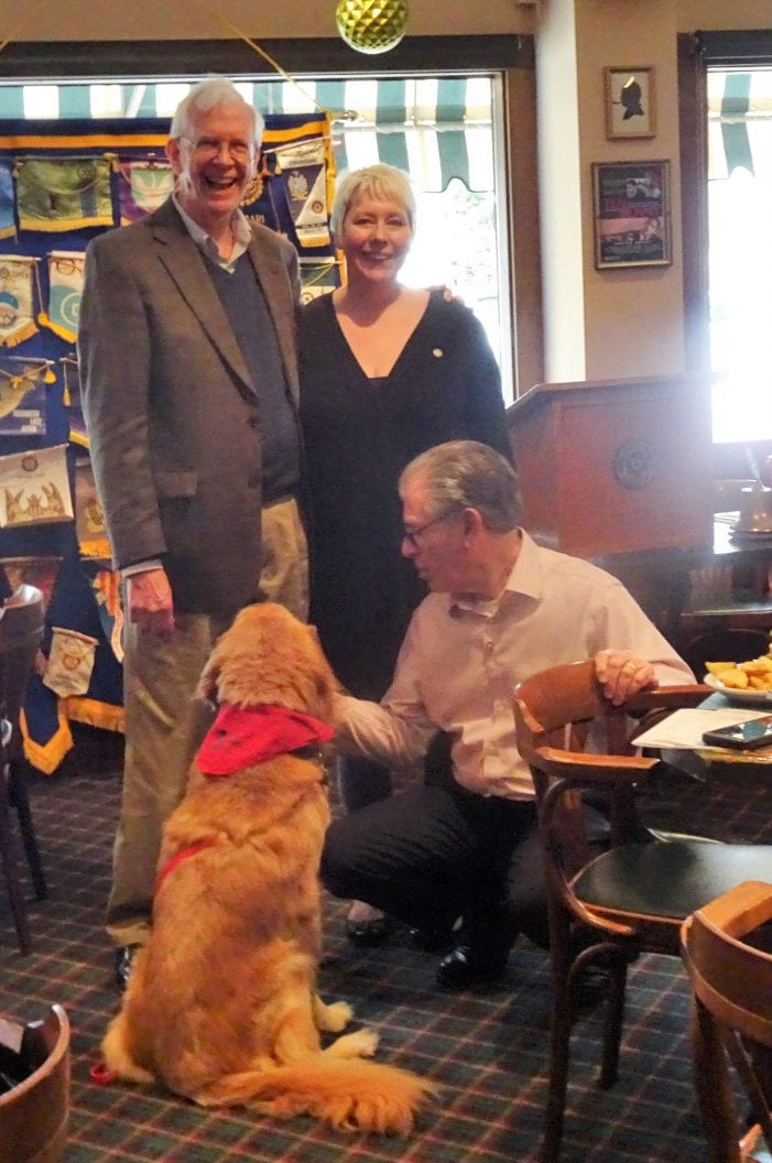 Charlie the Lab comes to the Rotary Club of Caldwell.