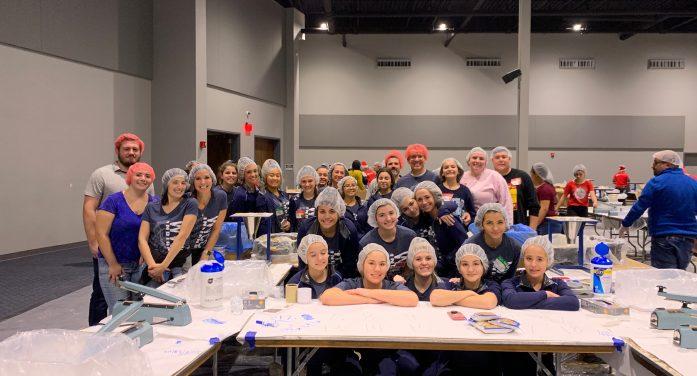 Wayne Valley Cheer team serves at outreach