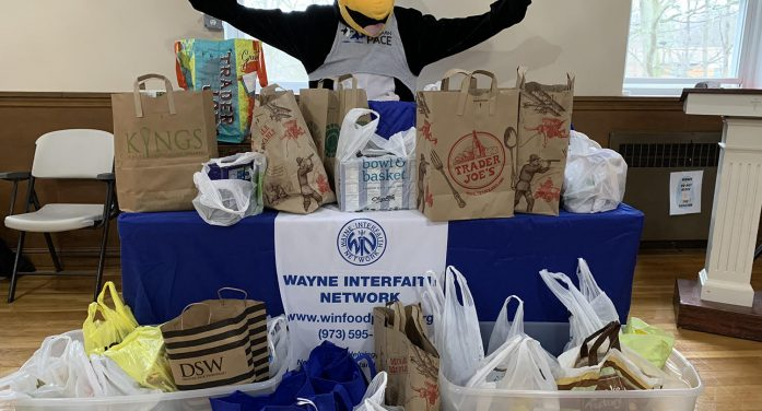 Penguin Pace 5K Brings Donation to Wayne Interfaith Network Food Pantry.