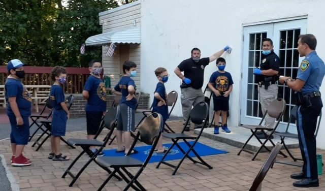 Cub Scouts Take Part in Forensics Demonstration with Local Police and Sheriff's Office